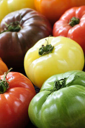 heirloom: Close up group of multi colored heirloom tomatoes