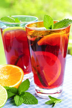 Refreshing fruit punch in two glasses outside photo
