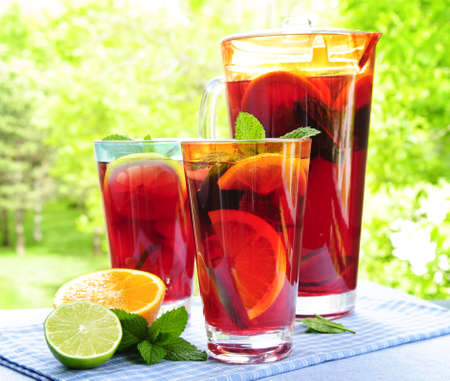 jugs: Refreshing fruit punch beverage in pitcher and glasses