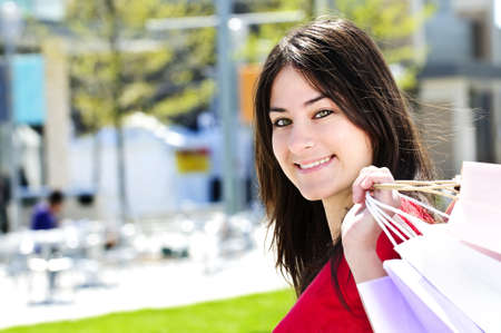 Portrait of young woman with shopping bags at outdoor mall Stock Photo - 5021014