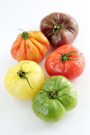 heirloom: Multi colored heirloom tomatoes isolated on white background Stock Photo