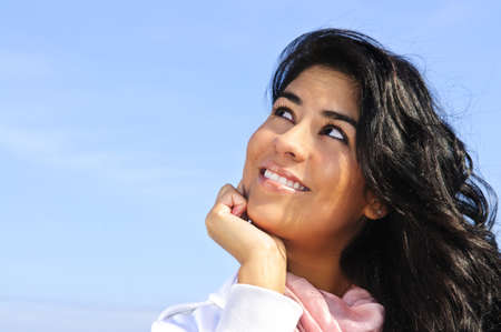 beautiful indian girl face: Portrait of beautiful smiling girl looking up Stock Photo