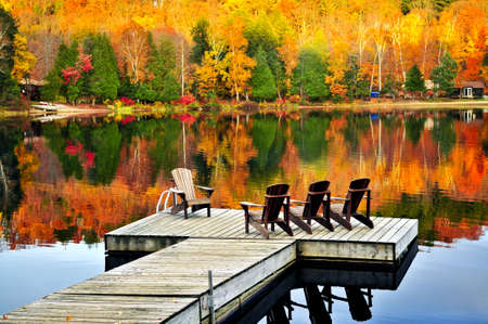 ontario: Wooden dock with chairs on calm fall lake
