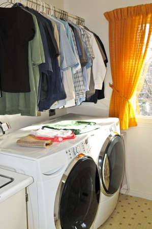 laundry room: Laundry room with modern washer and dryer