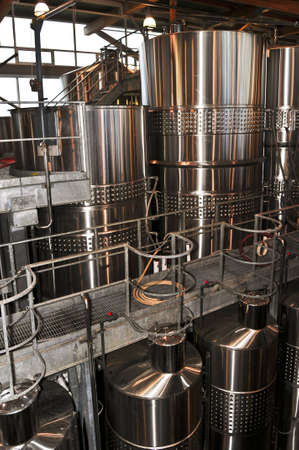 vintages: Wine making vats and equipment in tour of winery Stock Photo