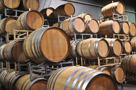 Stacked oak wine barrels in winery cellar Stock Photo - 5101565