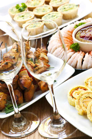 morsel: Many dishes of bite size appetizers and party food