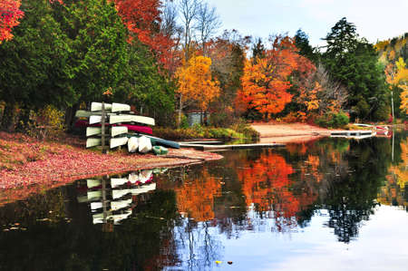 provincial forest parks: Canoes at forest of colorful autumn trees reflecting in calm lake Stock Photo