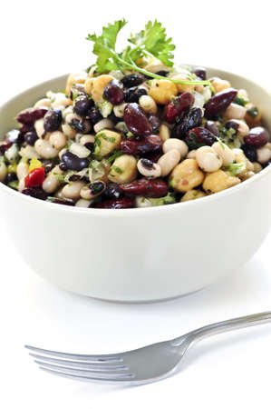 Isolated vegeterian salad of various beans in bowl close up photo