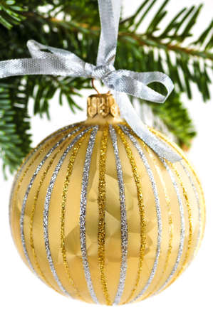 Golden Christmas decoration hanging on pine branch isolated on white Stock Photo - 5212857