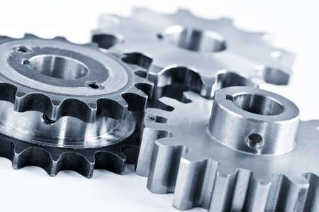 interleaved: Interlocking industrial metal gears isolated on white
