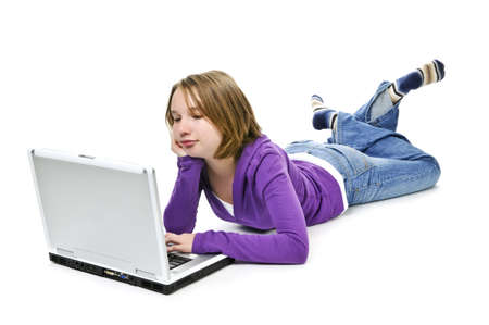 Young girl lying down with laptop computer