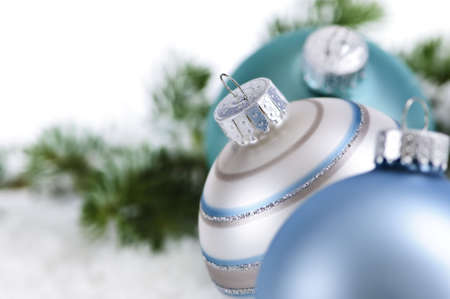 Closeup of three Christmas decorations sitting in snow Stock Photo - 5244948