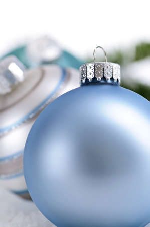 Closeup of three Christmas decorations sitting in snow Stock Photo - 5244949