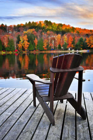 Wooden dock with chair on calm fall lake Stock Photo - 5244947