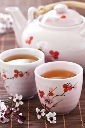 Green tea set with teapot and cups Standard-Bild