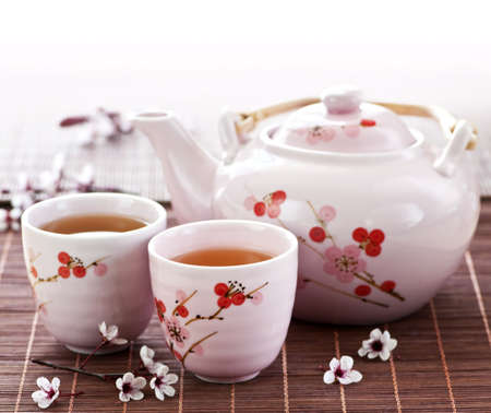 Green tea set with teapot and cups photo