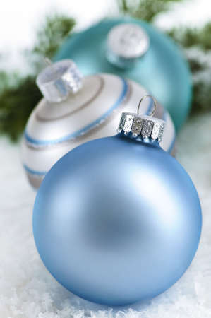 Closeup of three Christmas decorations sitting in snow Stock Photo - 5262214