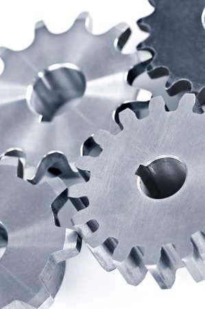 interlocking: Interlocking industrial metal gears isolated on white