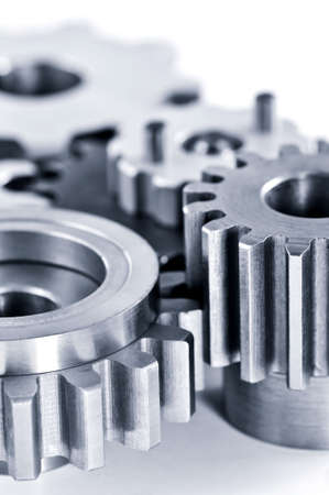 Interlocking industrial metal gears isolated on white photo