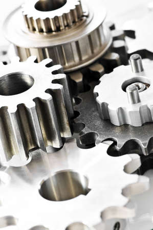machined: Industrial metal gears and machine parts connected
