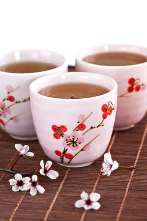filled: Three teacups filled with japanese green tea Stock Photo