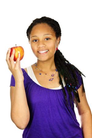 Isolated portrait of black teenage girl holding apple