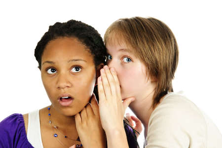 Isolated portrait of two diverse teenage girl friends gossiping photo