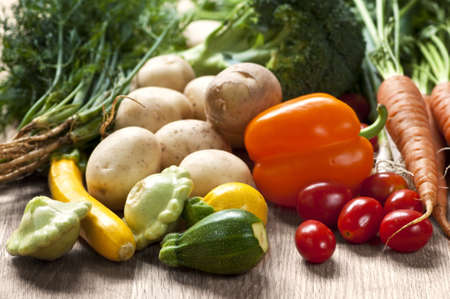 Bunch of whole assorted fresh organic vegetables photo