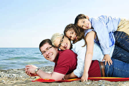 Portrait of a happy family having fun on a beach photo