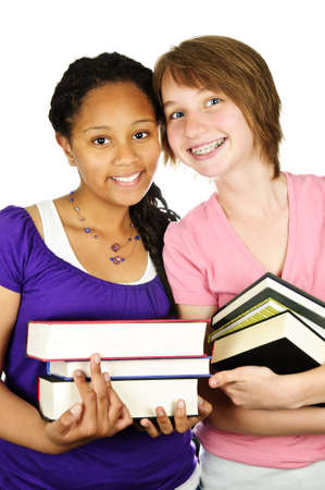 Isolated portrait of two teenage girls holding text books photo