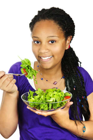 green leafy vegetables: Isolated portrait of black teenage girl with salad bowl