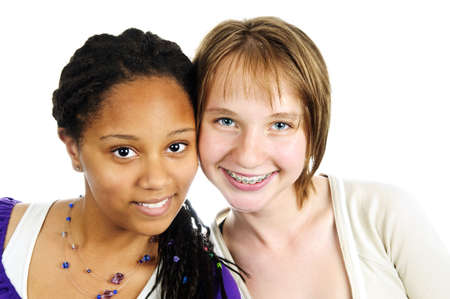 Isolated portrait of two diverse teenage girl friends photo
