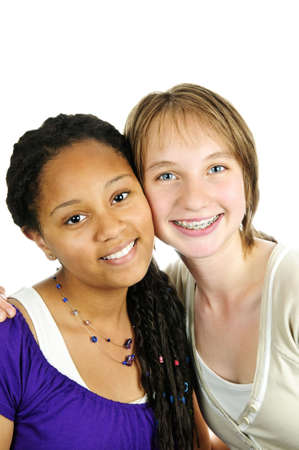 cute braces: Isolated portrait of two diverse teenage girl friends
