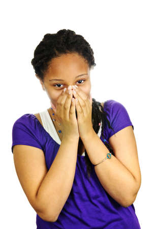 Isolated portrait of beautiful black teenage girl covering mouth photo