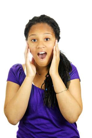 surprising: Isolated portrait of surprised black teenage girl