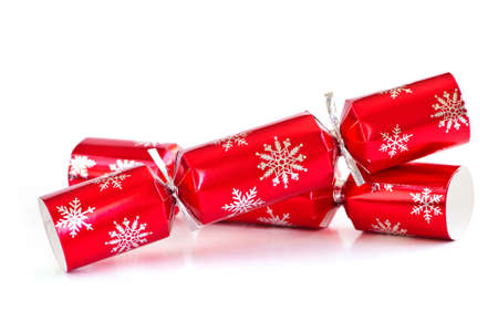Two red Christmas crackers isolated on white photo