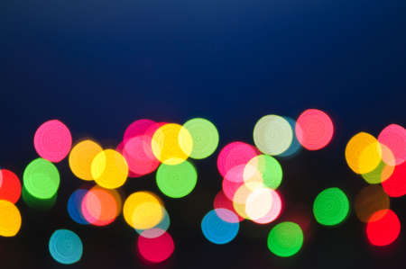 Out of focus multicolored Christmas light background photo
