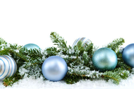decor: Many Christmas decorations laying in pine branches and snow