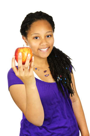 african student: Isolated portrait of black teenage girl holding apple