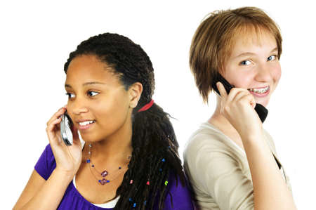 flip phone: Isolated portrait of two teenage girls with cell phones