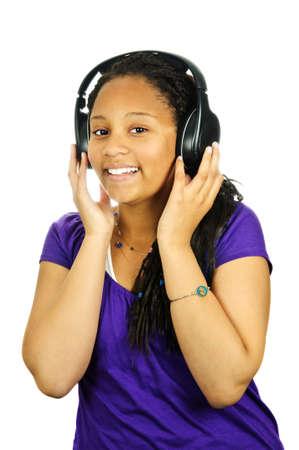 african student: Isolated portrait of black teenage girl listening to headphones Stock Photo