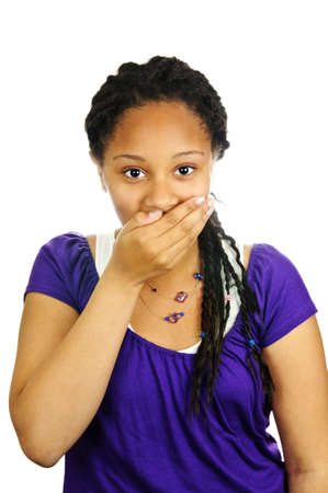 Isolated portrait of beautiful black teenage girl covering mouth Banco de Imagens - 5314383