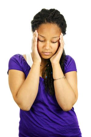 worried woman: Isolated portrait of worried teenage girl with headache Stock Photo