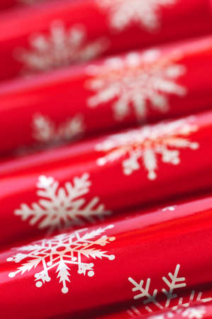Closeup of many red Christmas crackers in a row
