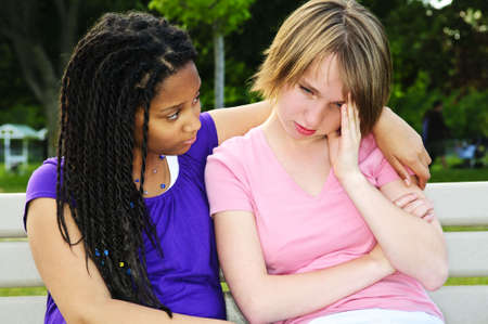 Teenage girl consoling her sad upset friend Stock Photo - 5343630