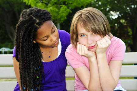 consoling: Teenage girl consoling her sad upset friend Stock Photo