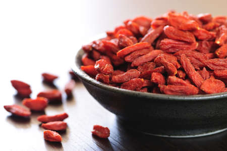 Full bowl of red dried goji berries Stock Photo - 5349087