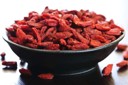 Full bowl of red dried goji berries photo