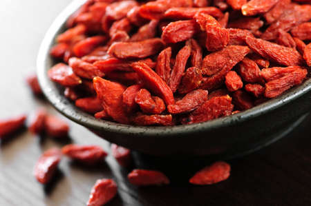 Full bowl of red dried goji berries photo